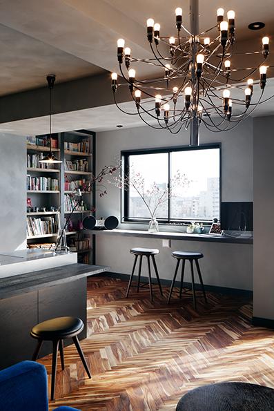 キッチンと同じ面材の窓辺のカウンター<br />川を見ながら一息